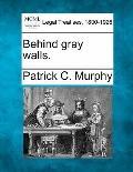Behind gray walls.